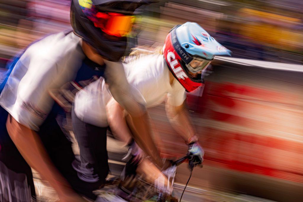 Two mountain bikers in a head-to-head race.
